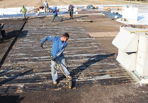 Commercial Roof Maintenance - Remove Rooftop Debris