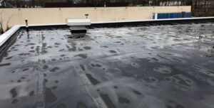 Frozen Wet Rooftop In Winter